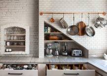 Slim-utility-rail-adds-metallic-copper-glint-to-the-modern-kitchen-in-white-with-ample-storage-space-48201-217x155
