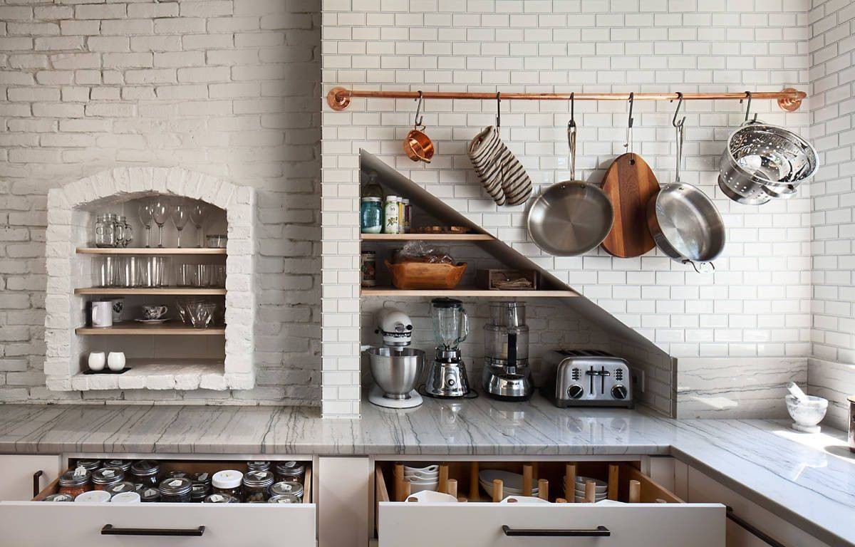 Slim-utility-rail-adds-metallic-copper-glint-to-the-modern-kitchen-in-white-with-ample-storage-space-48201