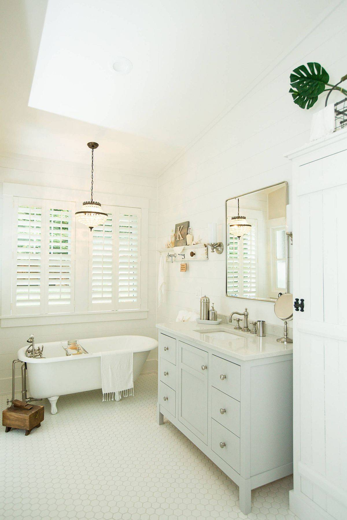 Small-all-white-bathroom-leans-more-toards-modern-than-farmhouse-79428