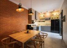 Small-kitchen-and-dining-area-of-the-lovely-Indonesian-home-withe-xposed-brick-walls-and-concrete-finishes-39640-217x155