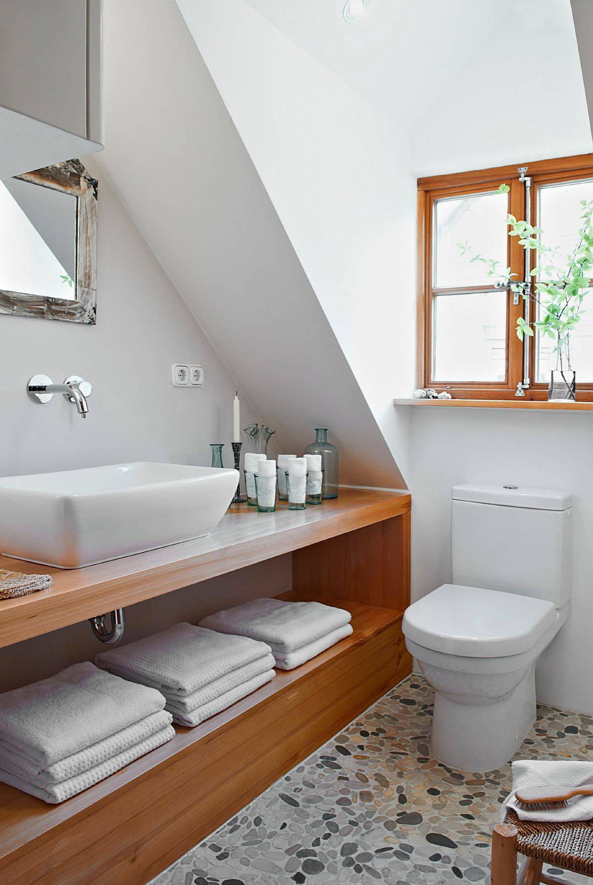 Small-wood-and-white-bathroom-with-terazzo-flooring-and-a-vanity-that-offers-ample-storage-space-79593