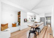 Smart-and-modern-extension-of-the-kitchen-island-is-a-wooden-breakfast-bar-that-brings-visual-contrast-to-the-space-70539-217x155