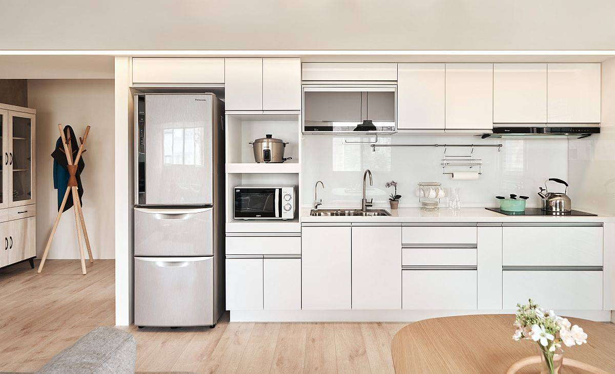 Smart and space-savvy single-wall kitchen in white with ample storage space