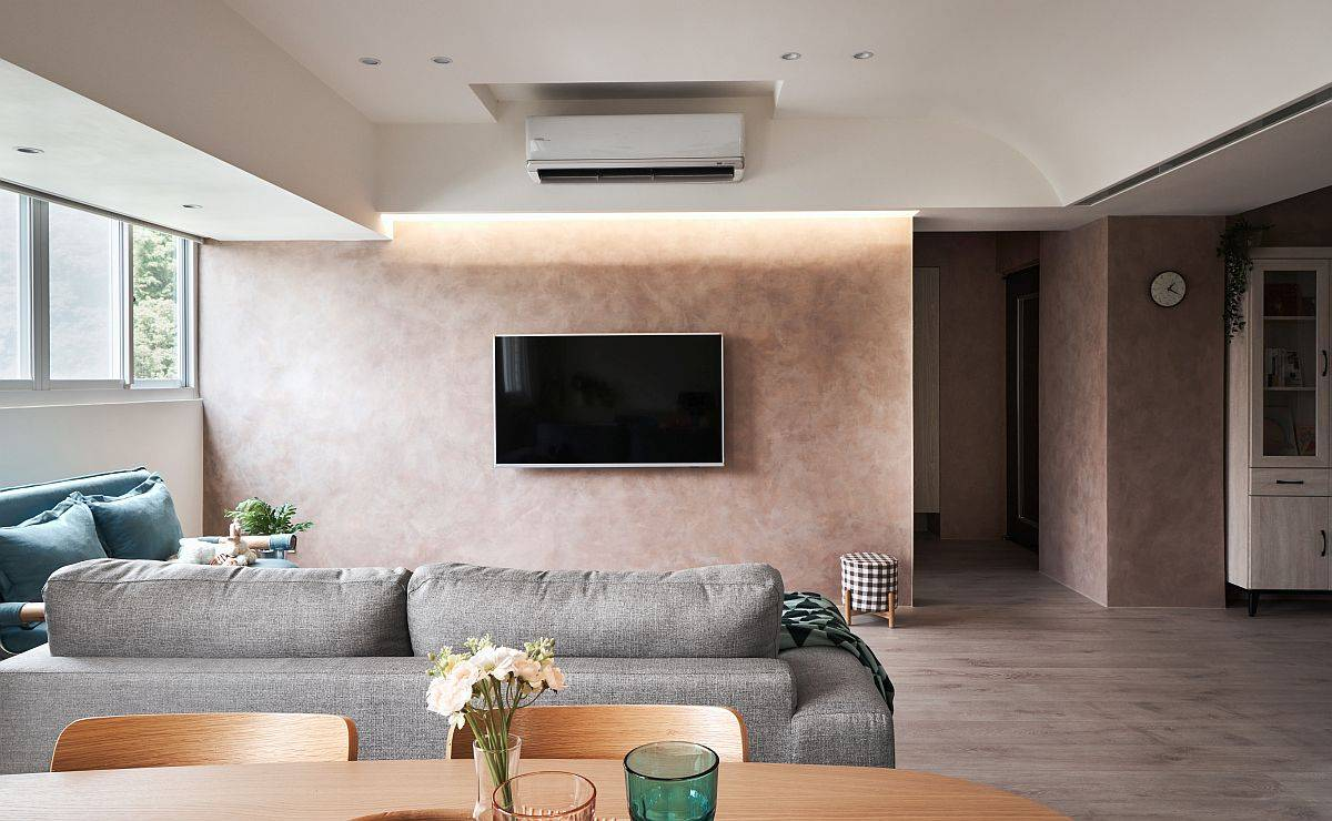 Snazzy and stylish LED lighting illuminates the accent wall in the living space beautifully