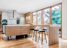 Spacious-and-stylish-wooden-breakfast-bar-offers-ample-sitting-space-for-entire-family-17242-217x155