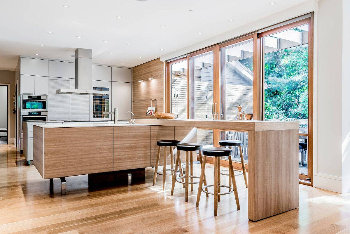 Spacious-and-stylish-wooden-breakfast-bar-offers-ample-sitting-space-for-entire-family-17242