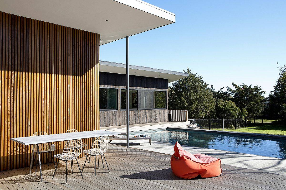Spacious deck, garden and pool area become a natural extension of the home interior at the Hamptons Bungalow