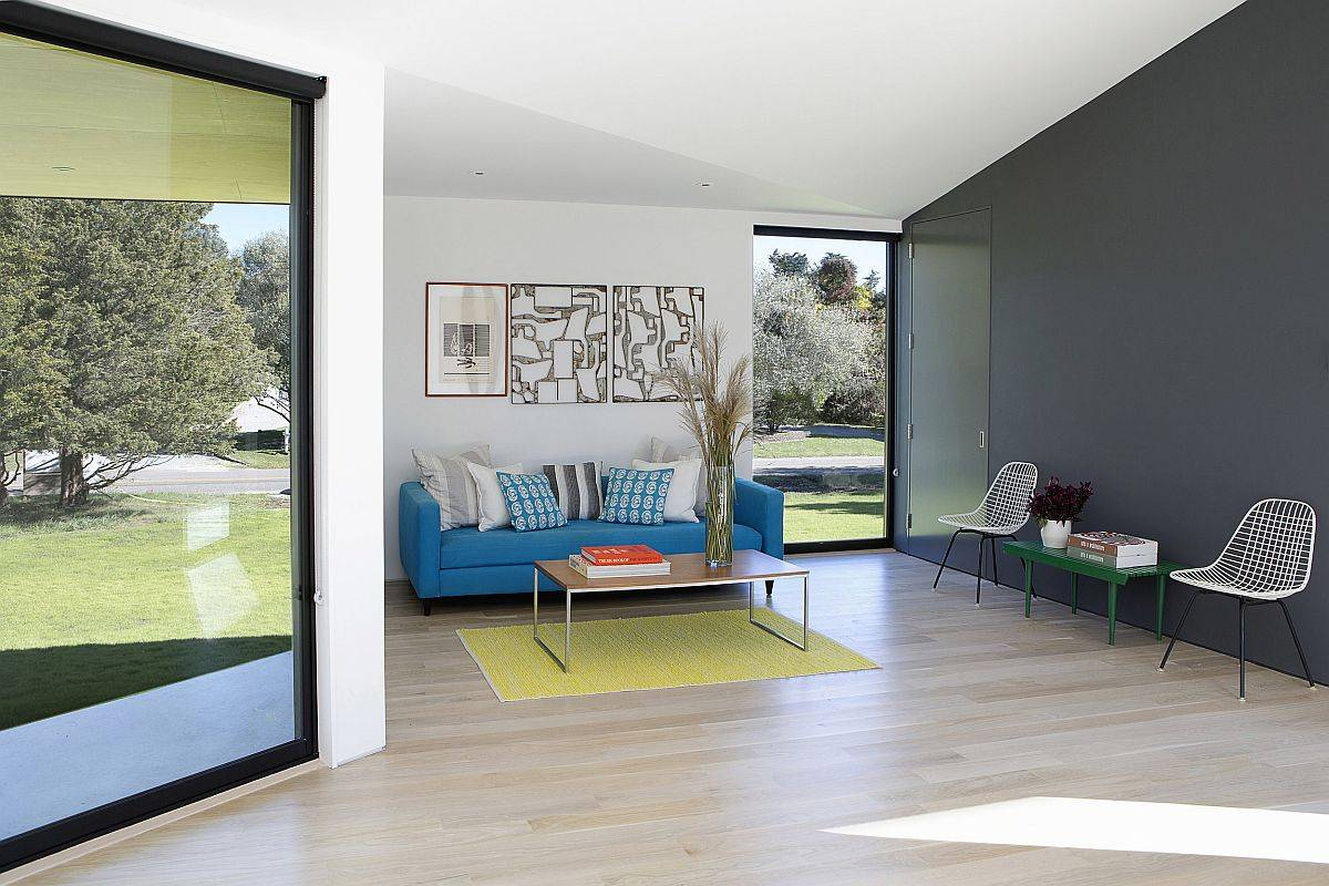 Touch-of-gray-accents-in-blue-and-green-along-with-neutral-colors-shape-the-living-area-and-the-entry-62714