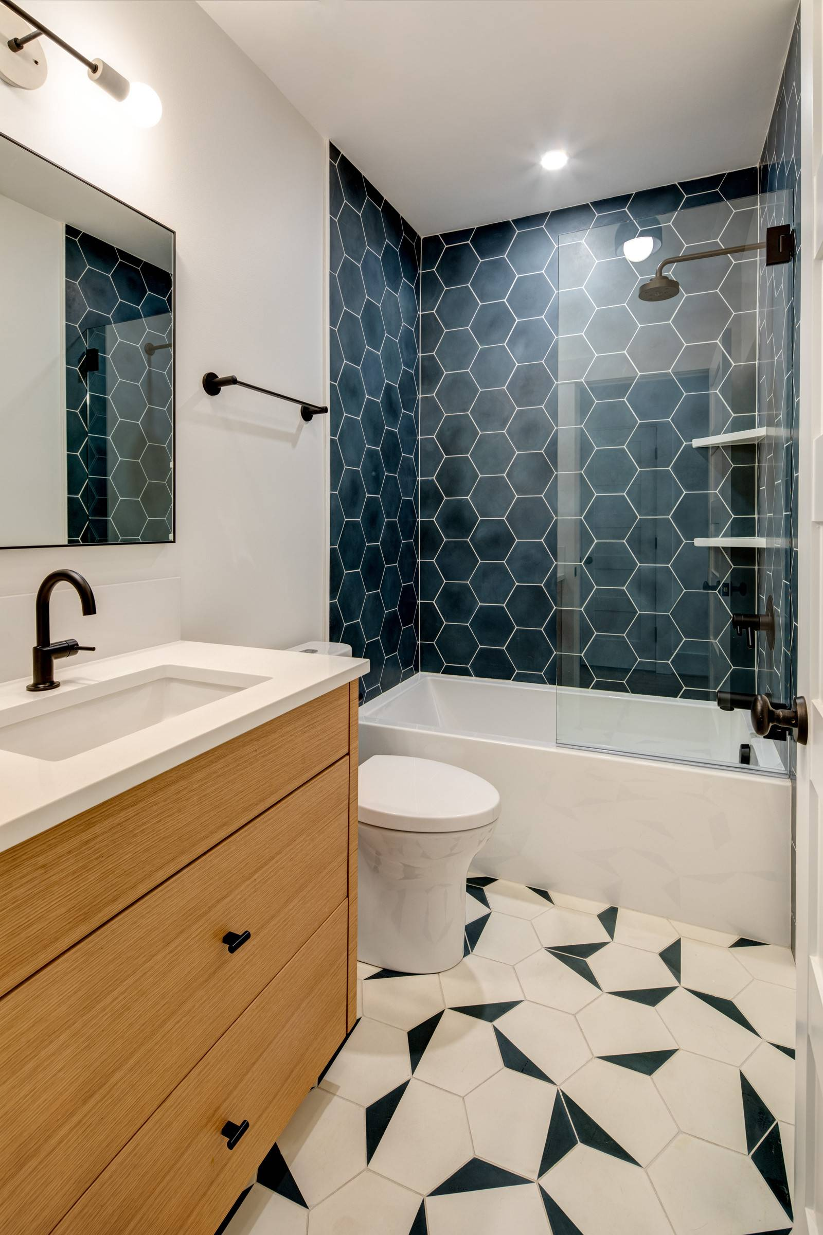Two-different-colored-hexagonal-styles-adorn-both-the-walls-and-the-floor-of-this-contemporary-bathroom-43154