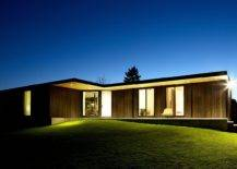 View-of-the-gorgeous-Hamptons-Bungalow-after-sunset-with-warm-lighting-and-its-lovely-wooden-exterior-14931-217x155