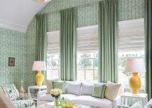 Wallpaper-and-drapes-bring-green-to-this-living-room-of-family-lake-retreat-70646-217x155