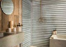 Weathered-wood-and-metal-sheets-add-an-entirely-different-dynamic-to-this-rustic-farmhouse-bathroom-35138-217x155