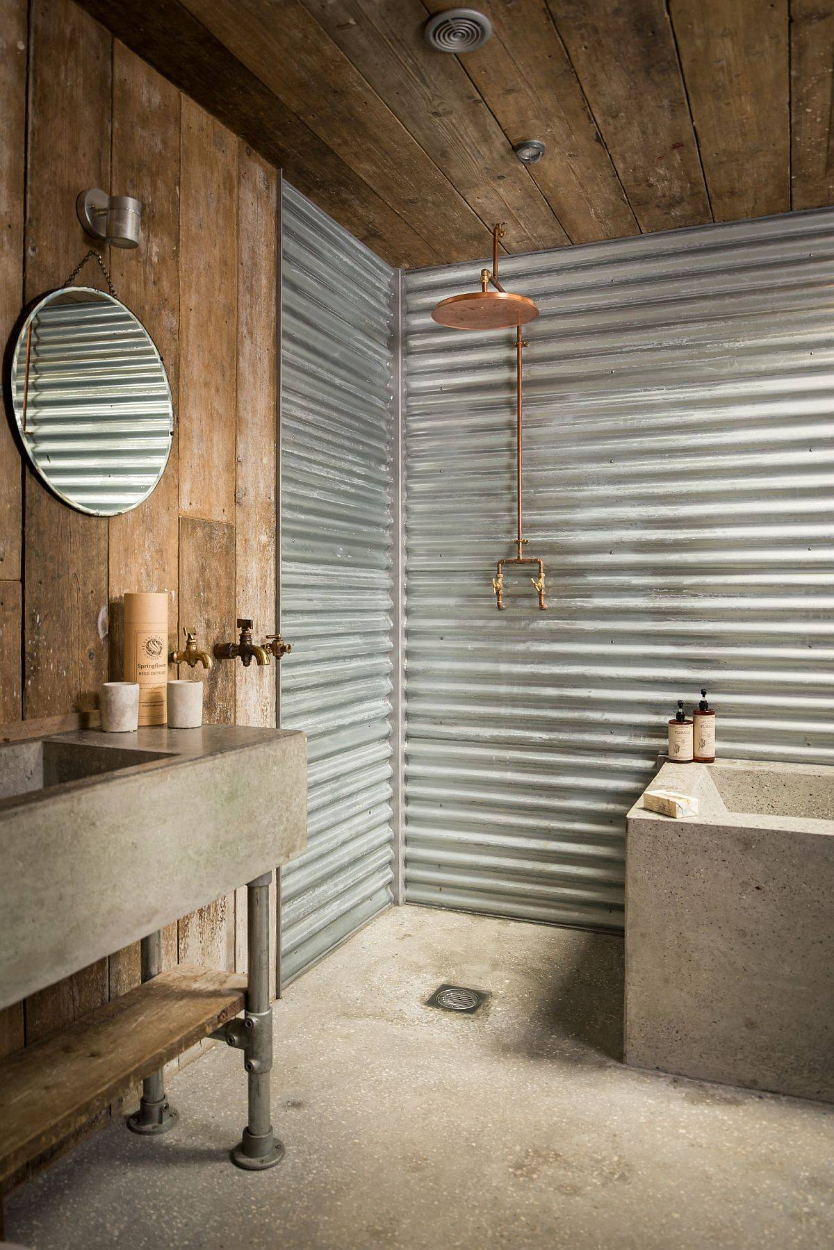 Weathered-wood-and-metal-sheets-add-an-entirely-different-dynamic-to-this-rustic-farmhouse-bathroom-35138