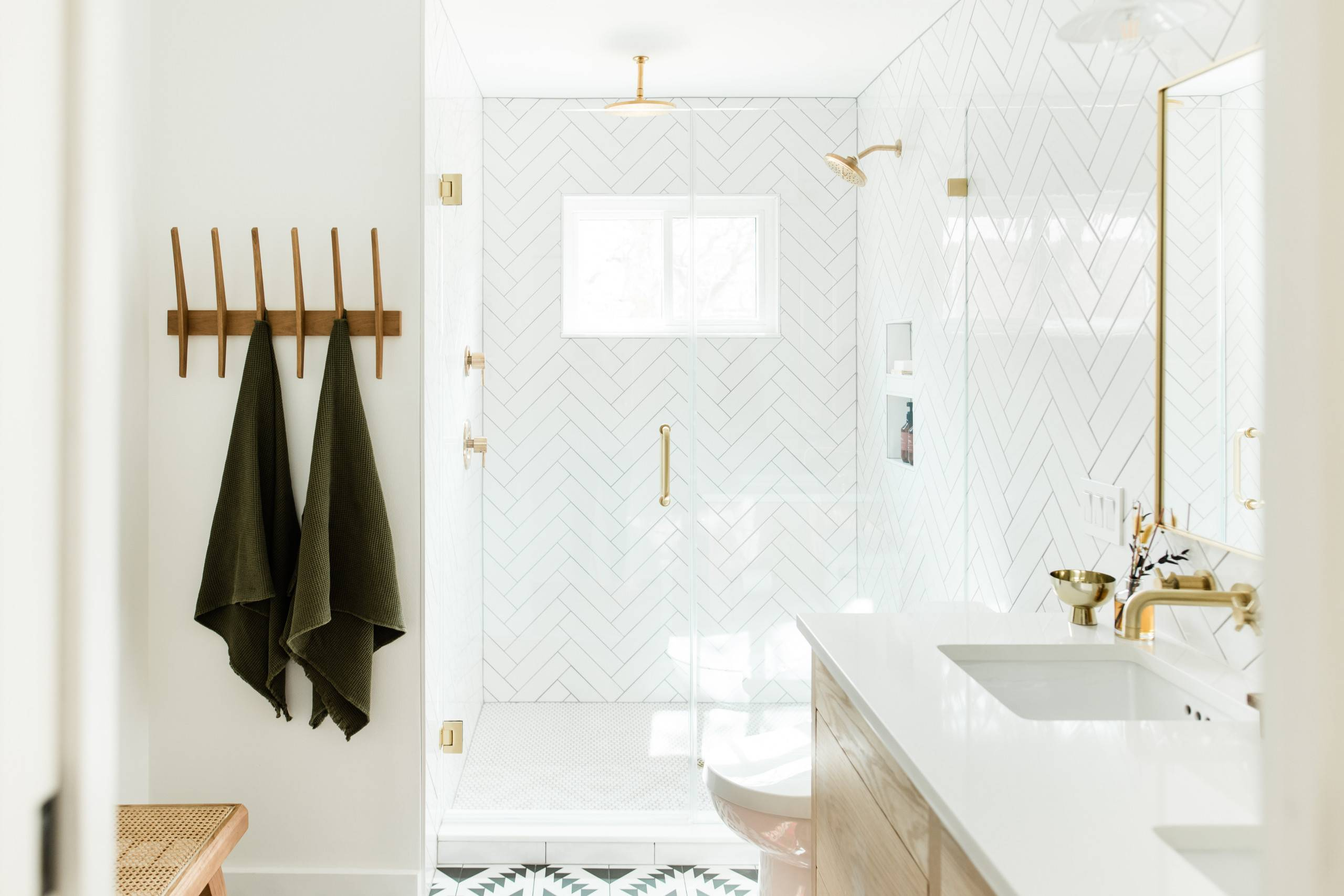 White-brass-and-wood-bathroom-with-herringbone-pattterned-shower-area-that-makes-a-difference-68743