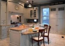Wooden-breakfast-bar-sits-at-a-level-lower-than-the-lovely-kitchen-counter-93173-217x155
