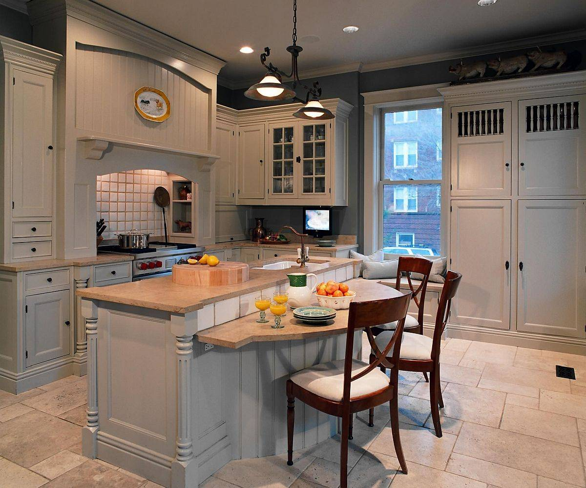 Wooden-breakfast-bar-sits-at-a-level-lower-than-the-lovely-kitchen-counter-93173