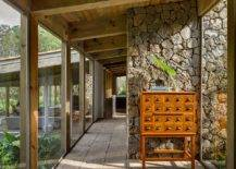 Wooden-ceiling-along-with-stone-walls-and-glass-floor-to-ceiling-walls-usher-in-a-whole-world-of-textures-18380-217x155