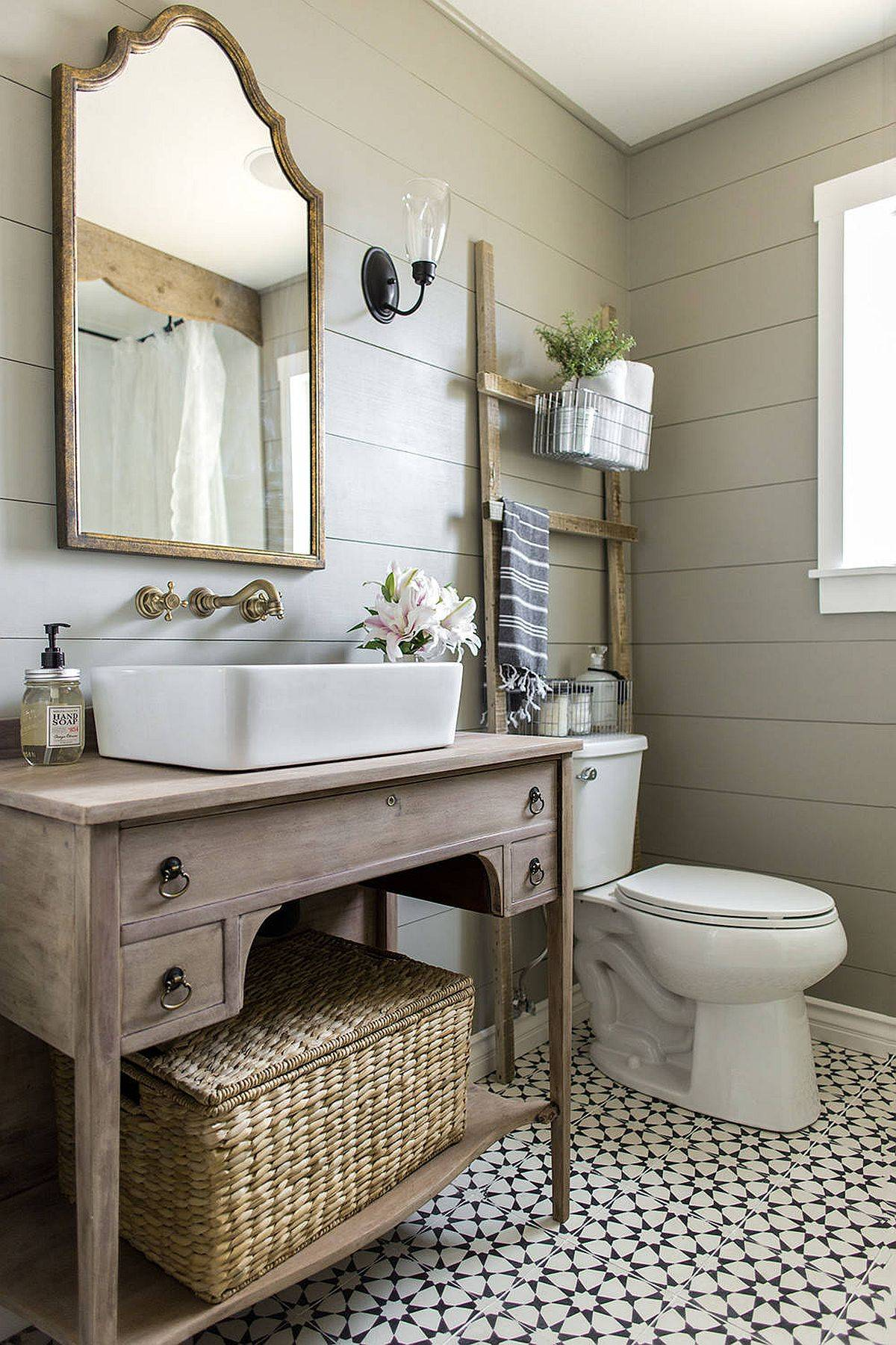 Wooden vanity, mirror frame and patterned tiles usher in farmhouse style