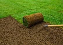 rolling sod while raking dirt