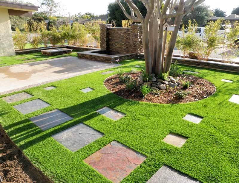 faux grass lawn with stone tiles