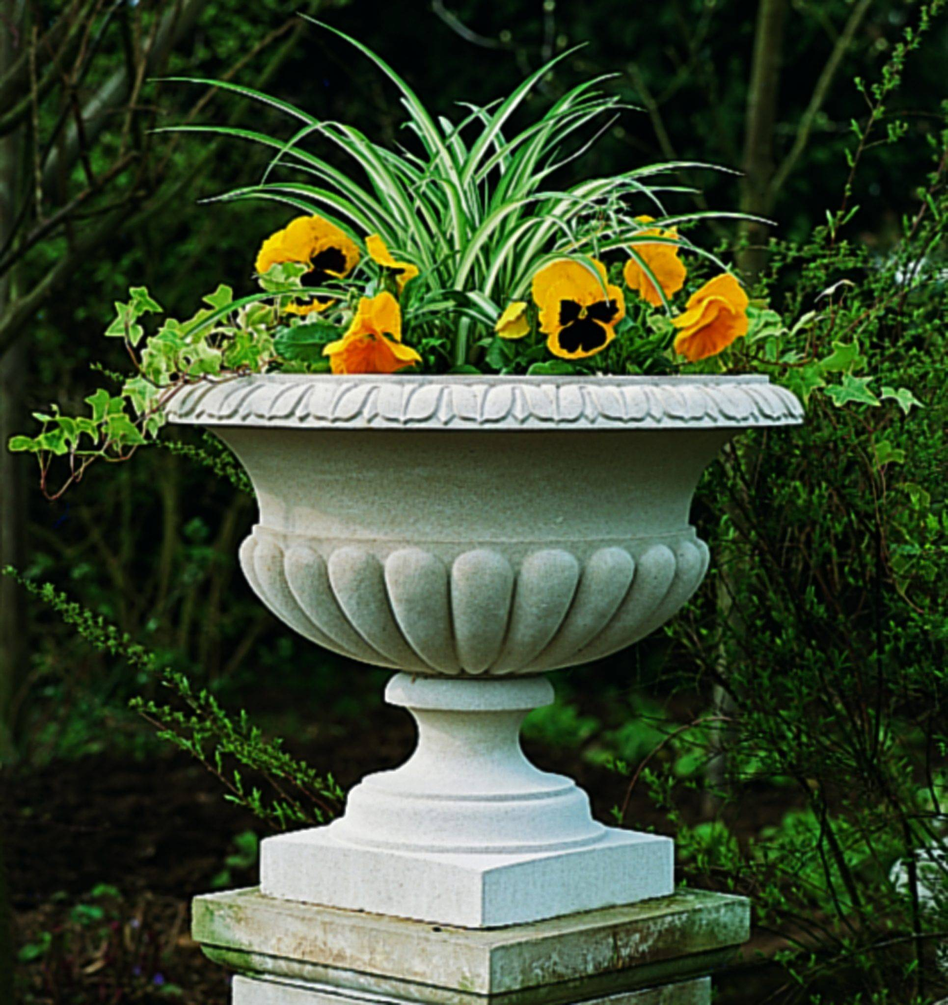 stone planter with colorful arrangement