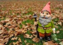 garden gnome in red hat with watering can
