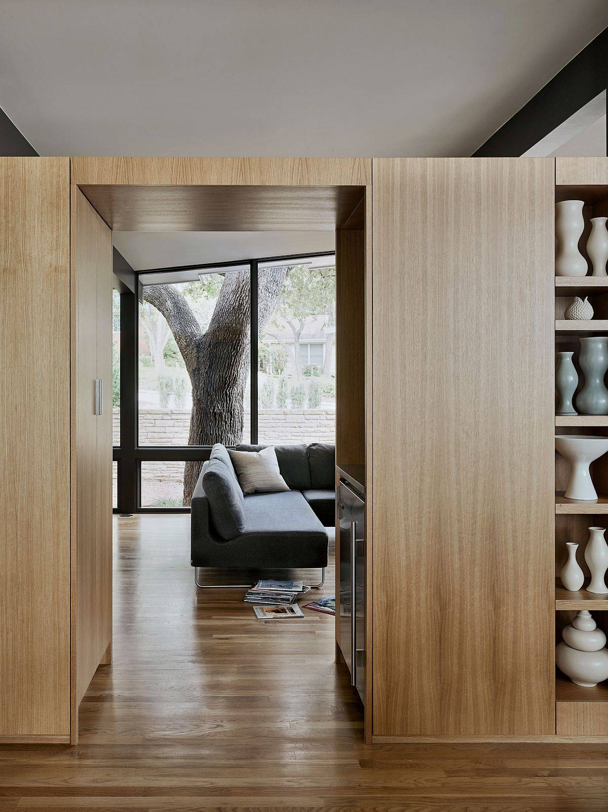 Art-collection-and-lovely-collection-of-vases-is-used-to-decorate-the-oak-cabinet-68915