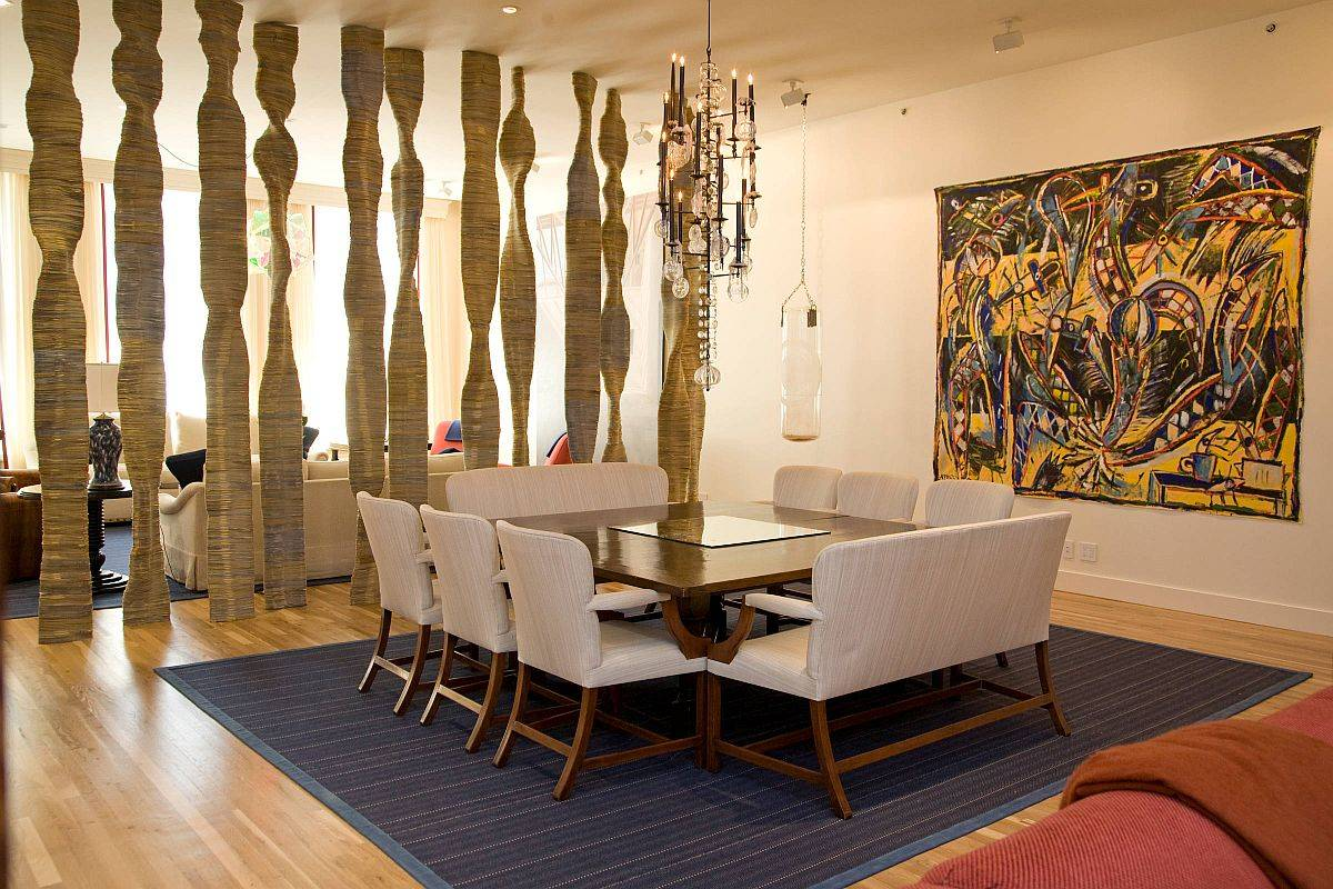 Artistic room divider steals the spotlight in this dashing dining room and living area