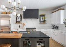 Beautiful-modern-farmhouse-kitchen-with-marble-backsplash-stone-countertops-and-industrial-style-bar-stools-49285-217x155