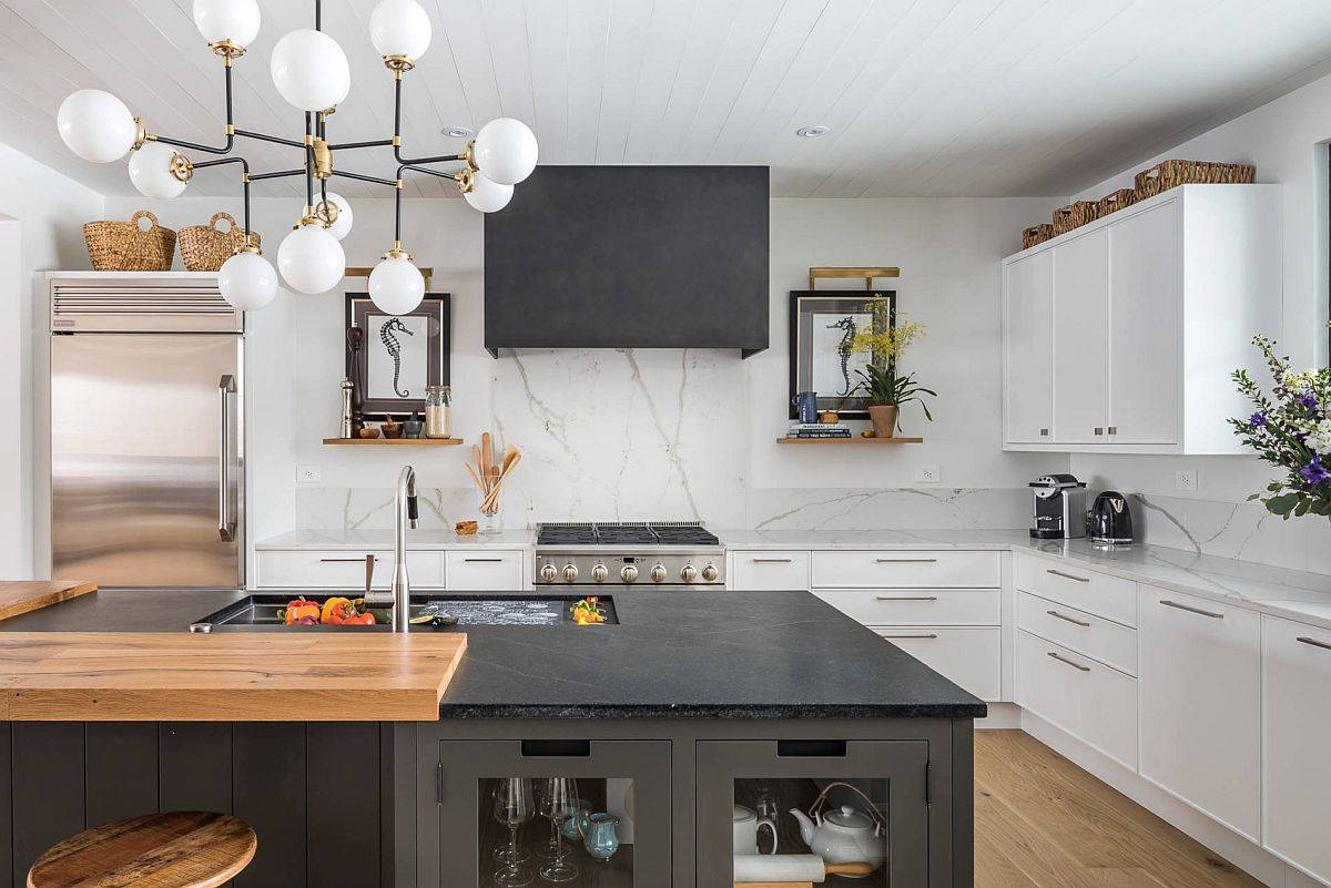 Beautiful modern farmhouse kitchen with marble backsplash, stone countertops and industrial style bar stools
