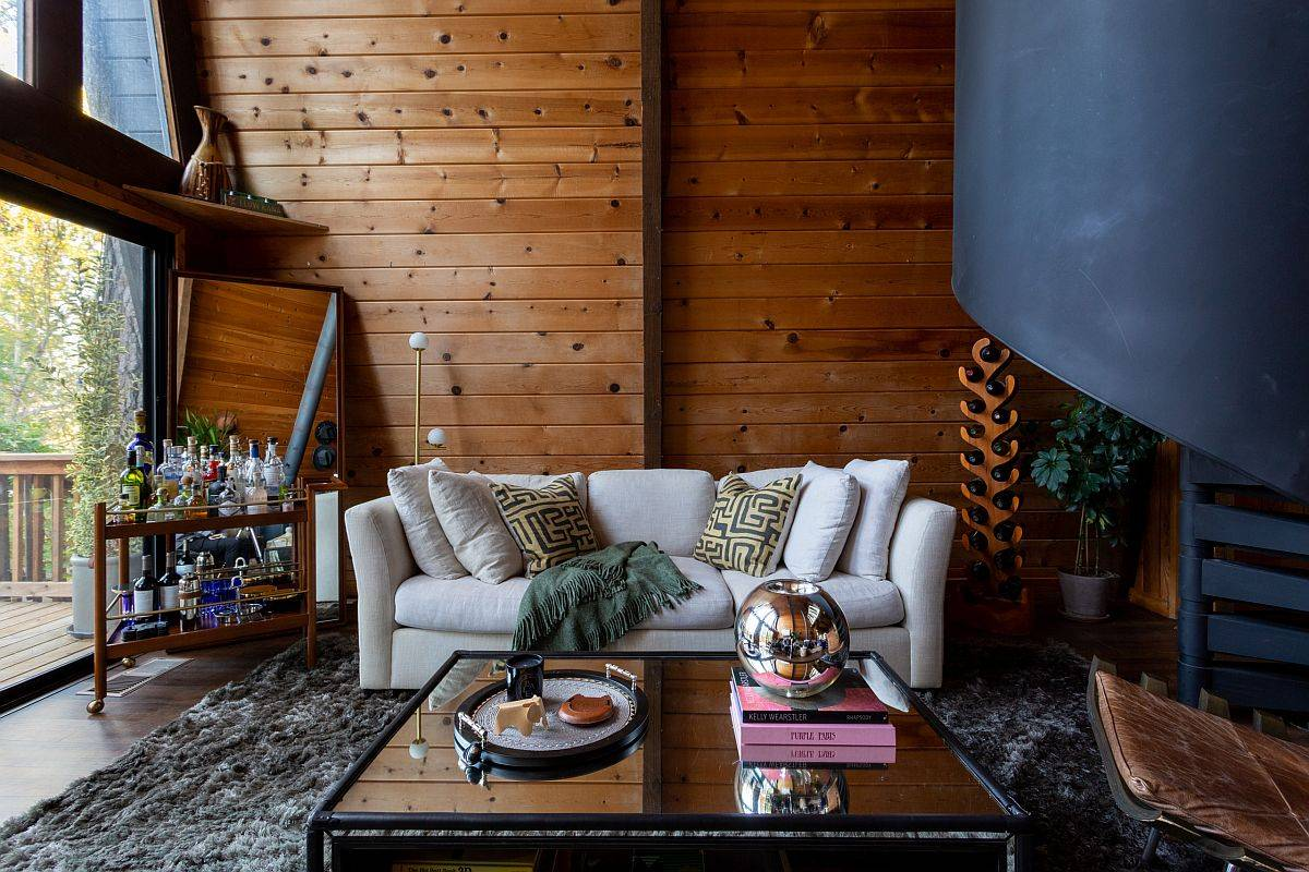 Beautiful modern rustic living room with woodsy backdrop and a comfy couch in white