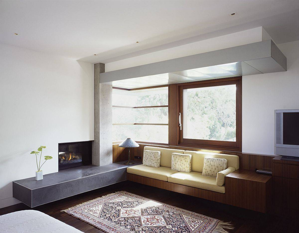 Beautiful-wooden-built-in-bench-next-to-the-fireplace-in-wood-feels-minimal-and-modern-25657