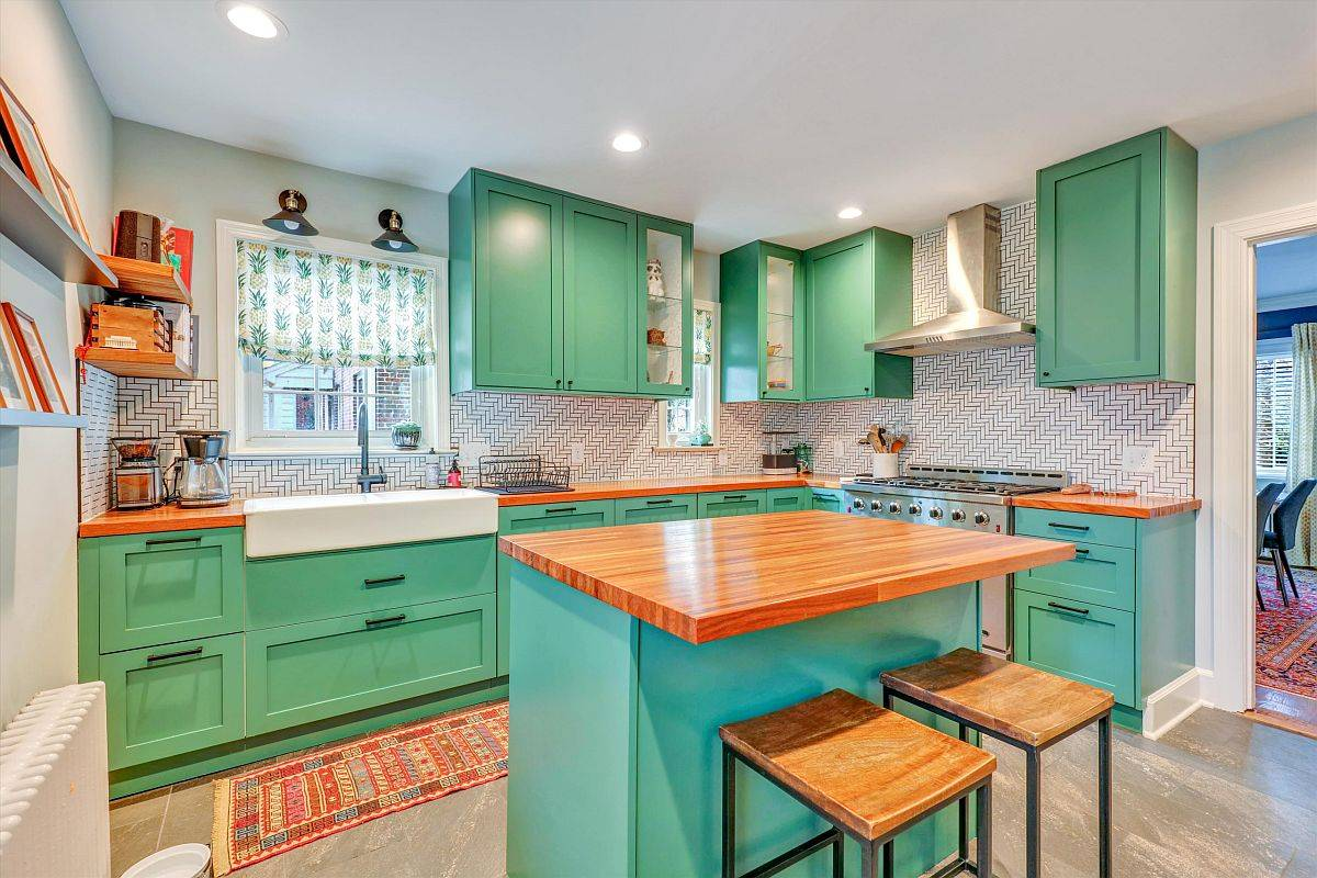 Bright-and-beautiful-modern-kitchen-is-draped-in-a-lovely-shade-of-sea-green-along-with-blue-for-the-island-14591