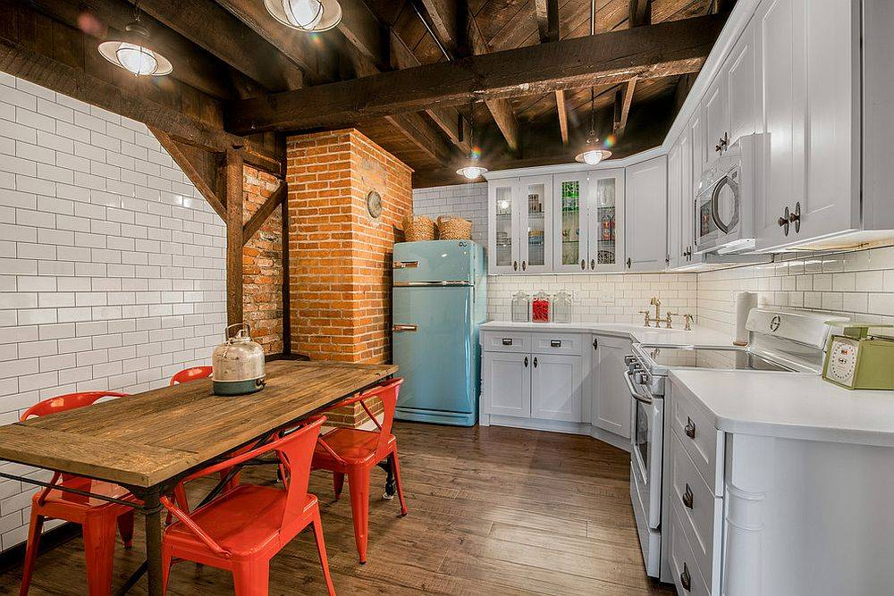 Bright red chairs and vintage refrigerator add color to this small modern farmhouse kitchen