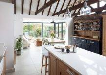 Charming-little-kitchen-connected-with-the-backyard-embraces-white-and-gray-along-with-exposed-wood-ceiling-beams-and-brick-wall-section-28366-217x155