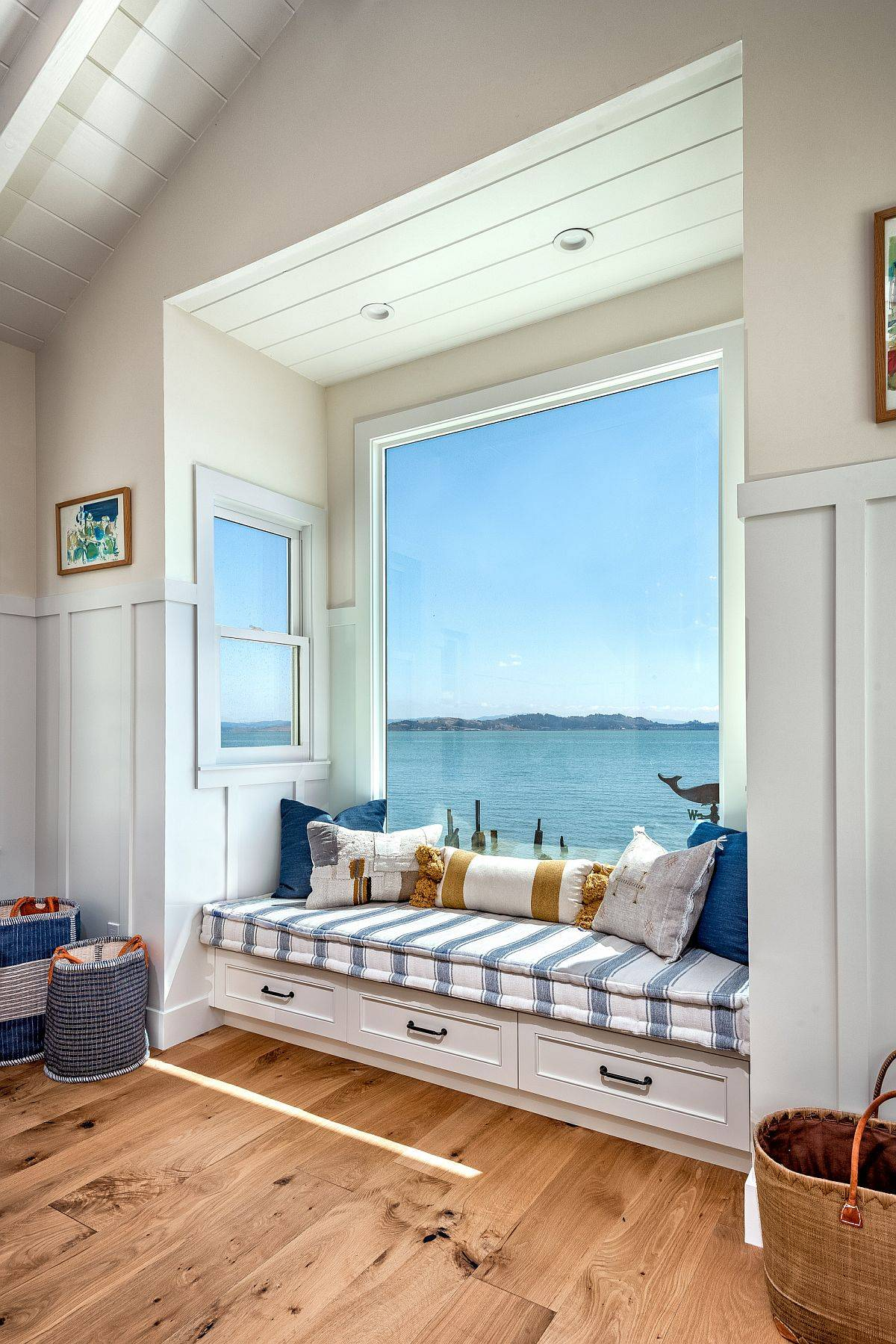 Coastal-style-built-in-bench-is-just-perfect-for-this-family-room-with-ocean-views-92705