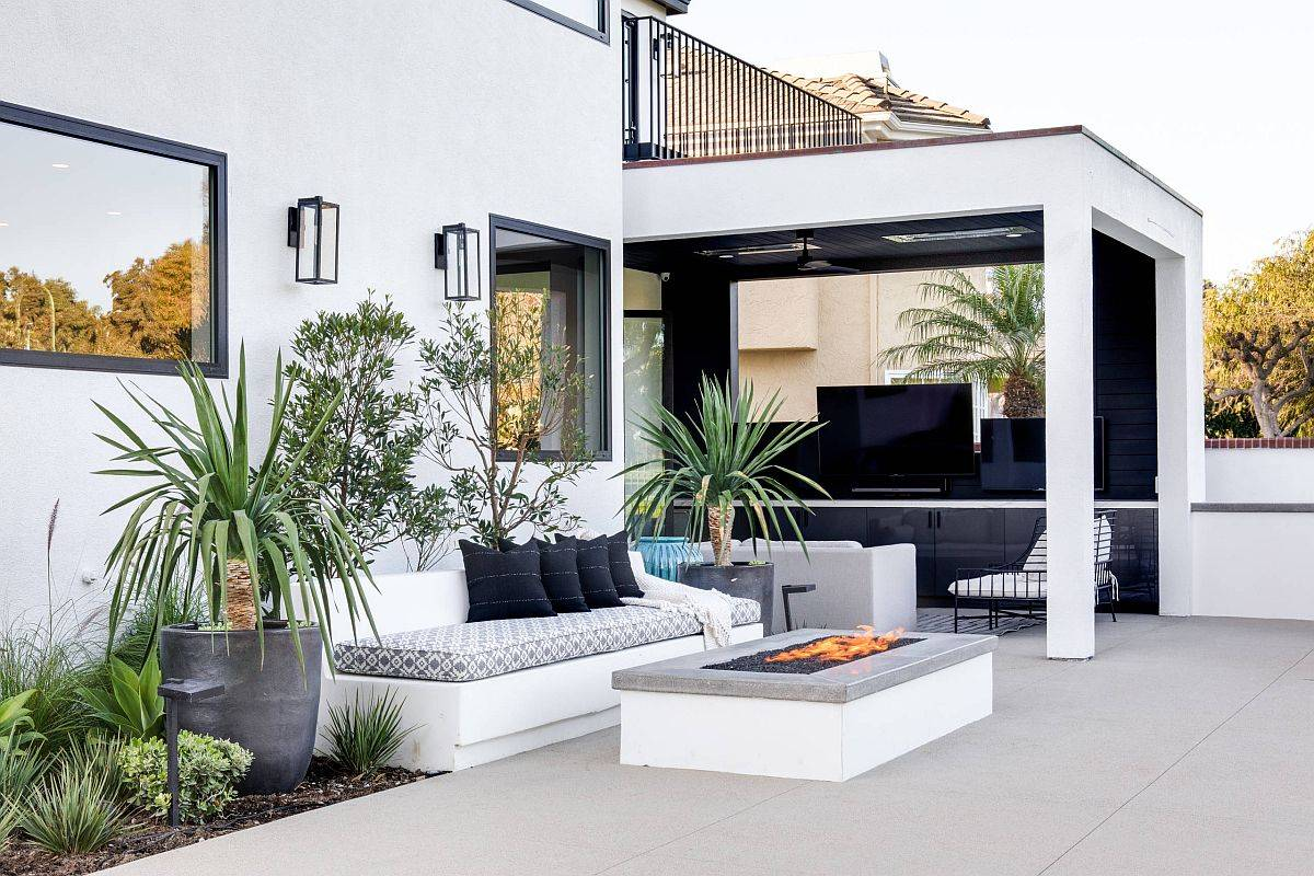 Comfy-contemporary-outdoor-built-in-bench-with-a-gorgeous-fireplace-next-to-it-65941