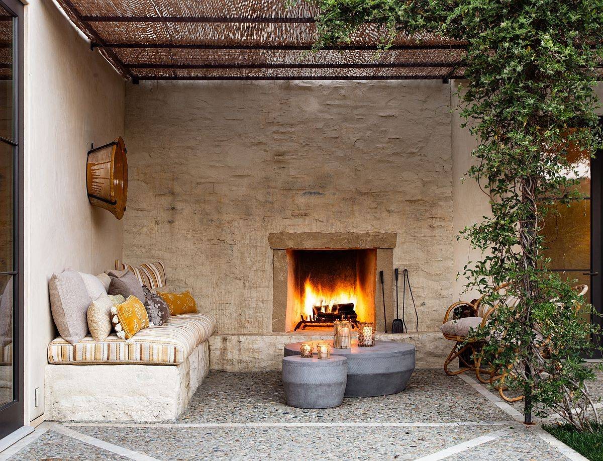 Cozy and timeless Mediterranean patio with a built-in bench that oozes class and luxury