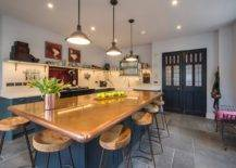 Custom-copper-countertop-island-also-doubles-as-a-fabulous-dining-area-inside-this-eat-in-kitchen-24381-217x155