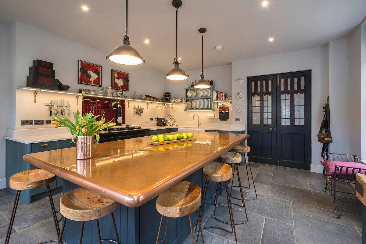 Custom-copper-countertop-island-also-doubles-as-a-fabulous-dining-area-inside-this-eat-in-kitchen-24381