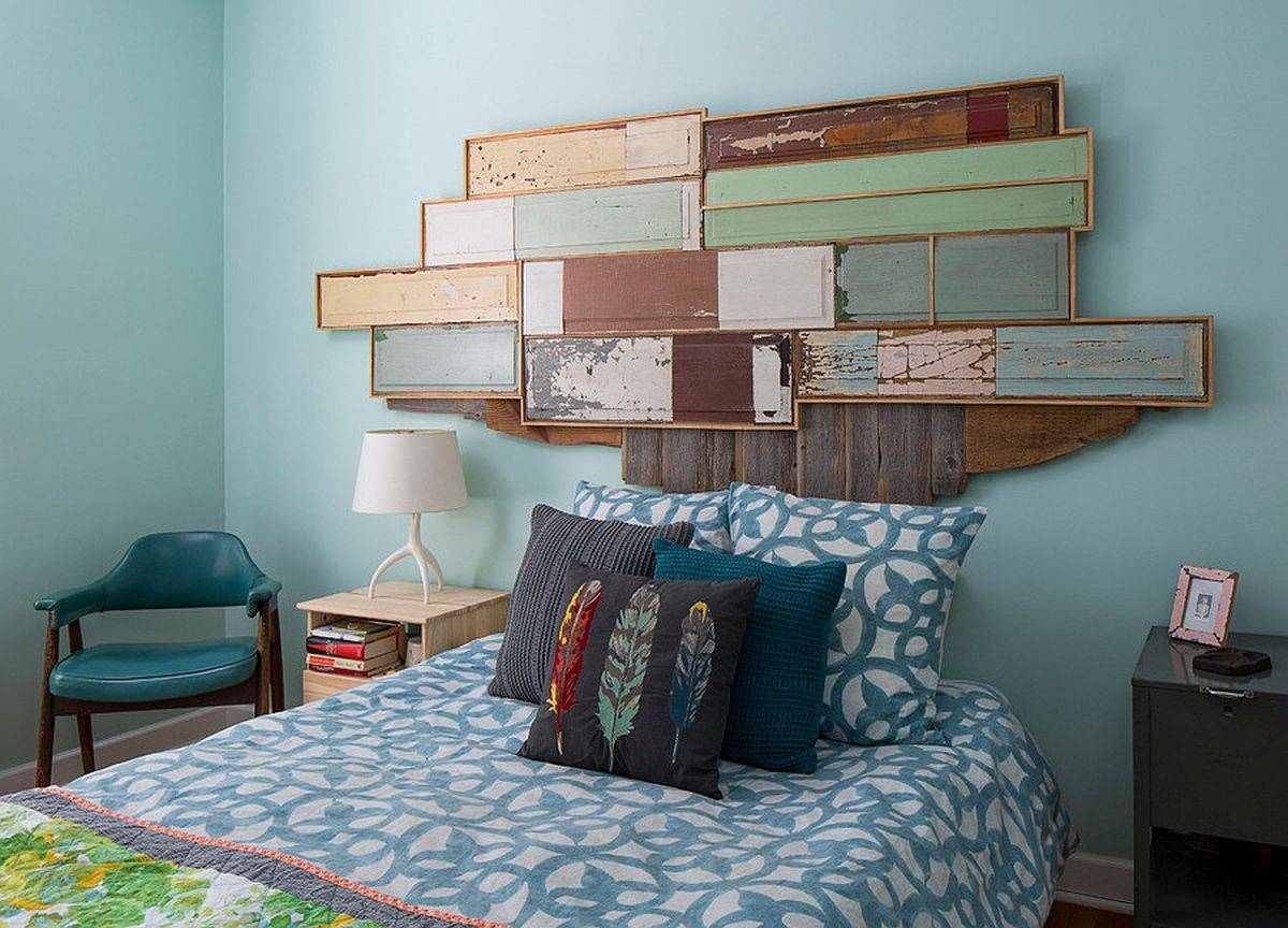 Custom headboard inspired by the shape of US map is made from reclaimed wooden doors