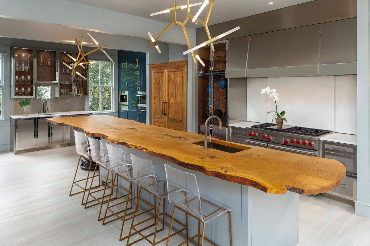 Custom island of eat-in kitchen with live-edge counter that wows!