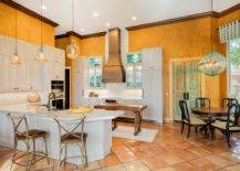 Custom-textured-walls-in-orange-make-the-biggest-visual-impact-in-this-spacious-mdoern-kitchen-94331-217x155