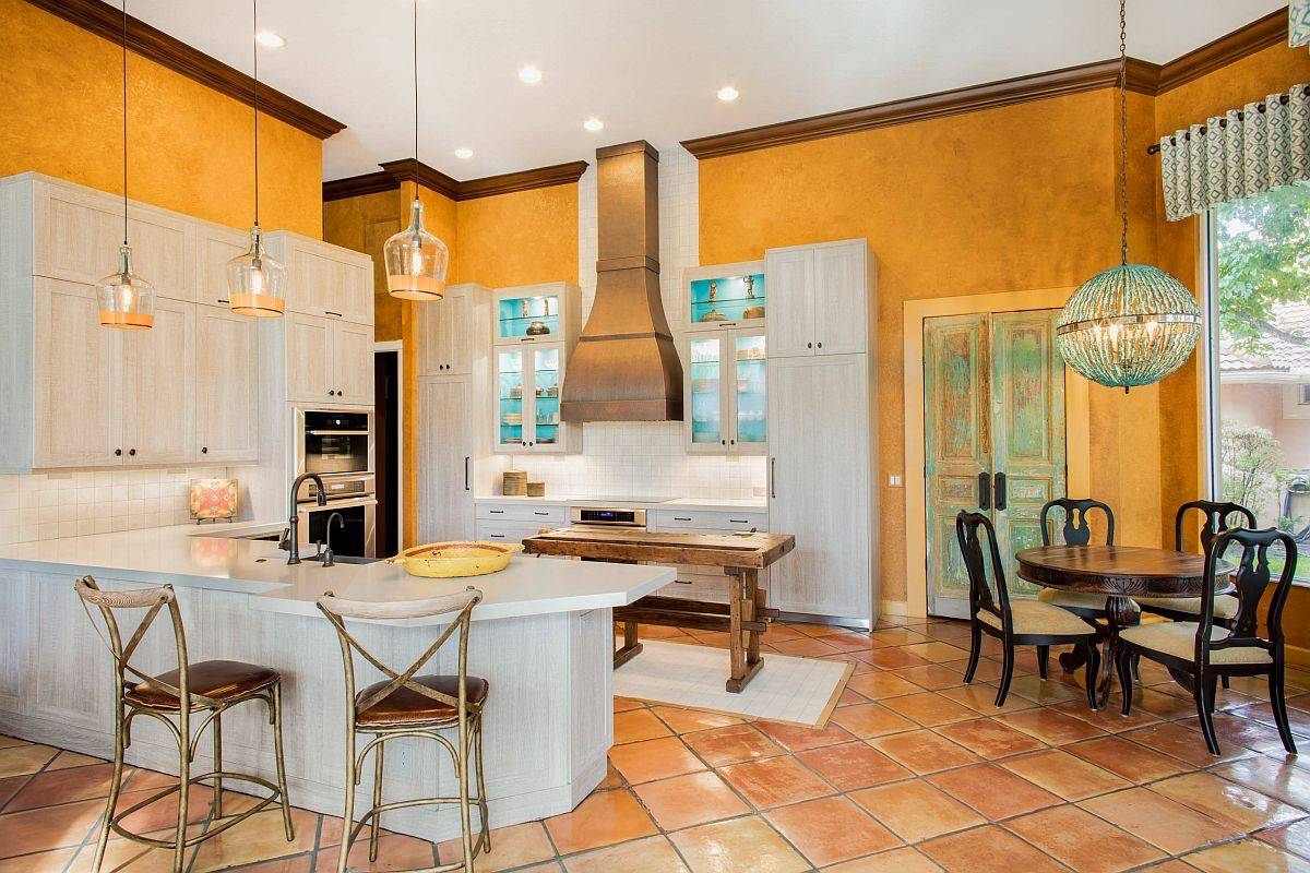 Custom-textured-walls-in-orange-make-the-biggest-visual-impact-in-this-spacious-mdoern-kitchen-94331