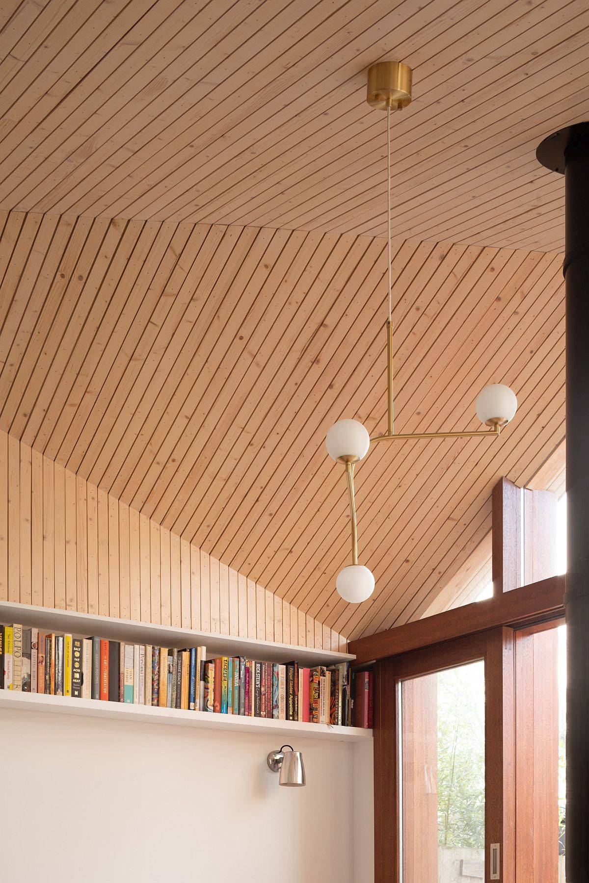 Custom-wooden-ceiling-of-the-extension-allows-in-filtered-light-throughout-the-day-62981