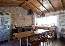 Dashing-industrial-farmhouse-eat-in-kitchen-with-a-brick-wall-and-large-wooden-table-at-its-heart-83925-217x155