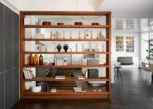 Elegant-and-minimal-bookshelf-in-wood-is-just-perfect-for-the-open-plan-living-area-and-neatly-hides-the-kitchen-88160-217x155