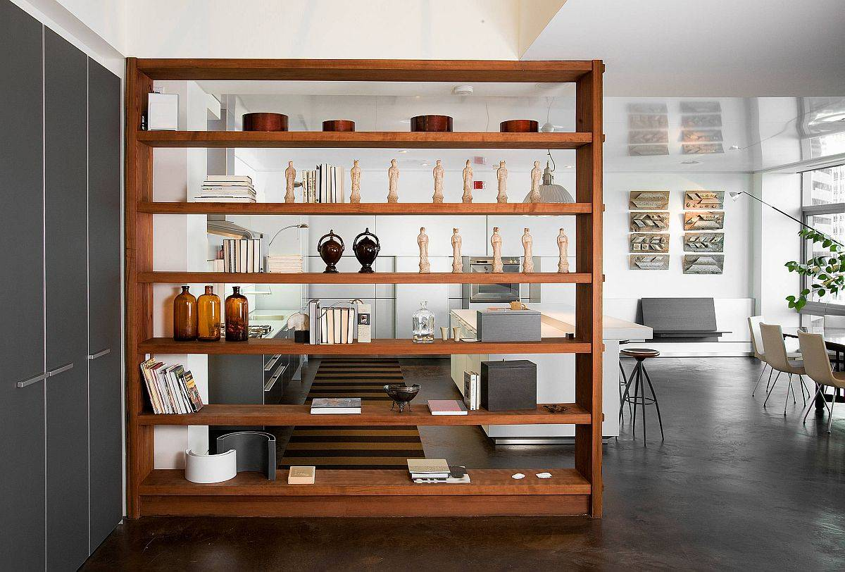 Elegant-and-minimal-bookshelf-in-wood-is-just-perfect-for-the-open-plan-living-area-and-neatly-hides-the-kitchen-88160