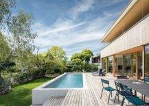 Expansive-wooden-deck-of-the-home-with-outdoor-dining-space-and-a-pool-that-offers-refreshing-ambiance-31589-217x155
