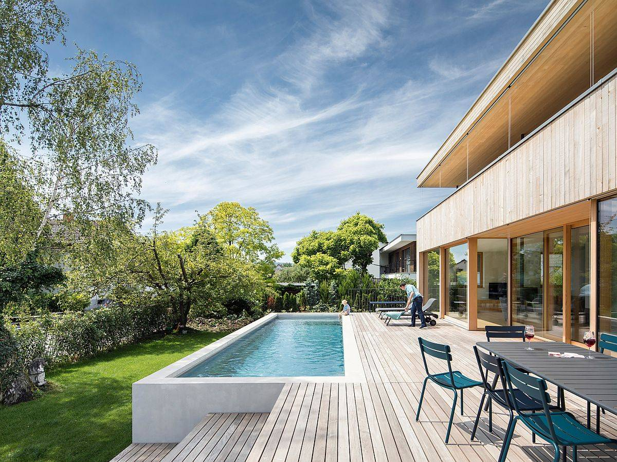Expansive-wooden-deck-of-the-home-with-outdoor-dining-space-and-a-pool-that-offers-refreshing-ambiance-31589